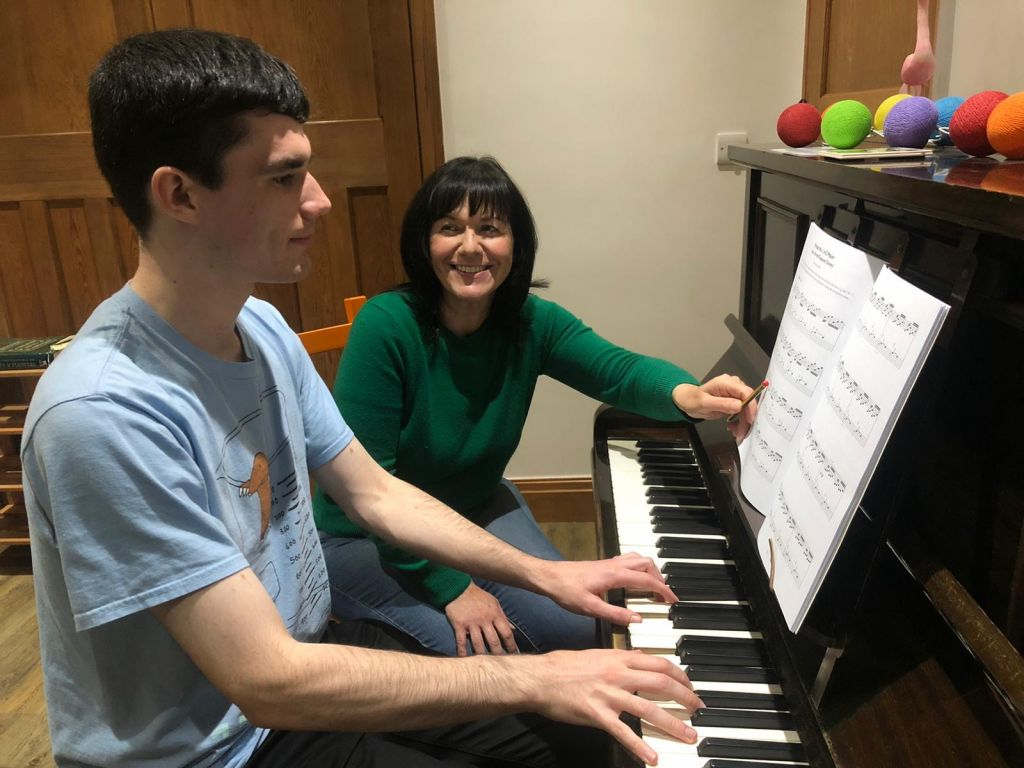 Fiona Robinson teaching a piano student